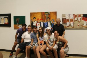The Sangroniz grandchildren pose with artist Bob Ithurralde under the painting of them.