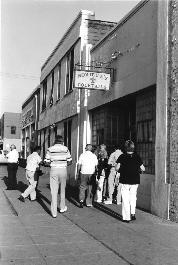 A crowd rushes to make the evening dinner serving at Noriega's.