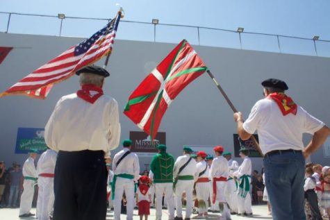 The Basque and U.S. flags fly during the Star Spangled Banner.