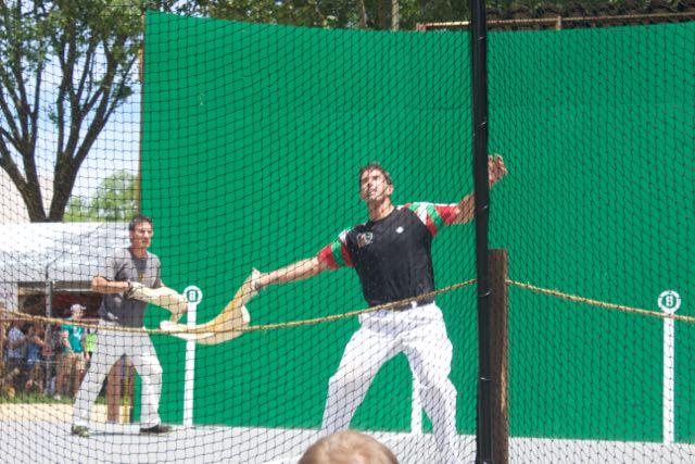 New England players demonstrate jai alai. Riki Lasa (front) was a professional jai alai player.