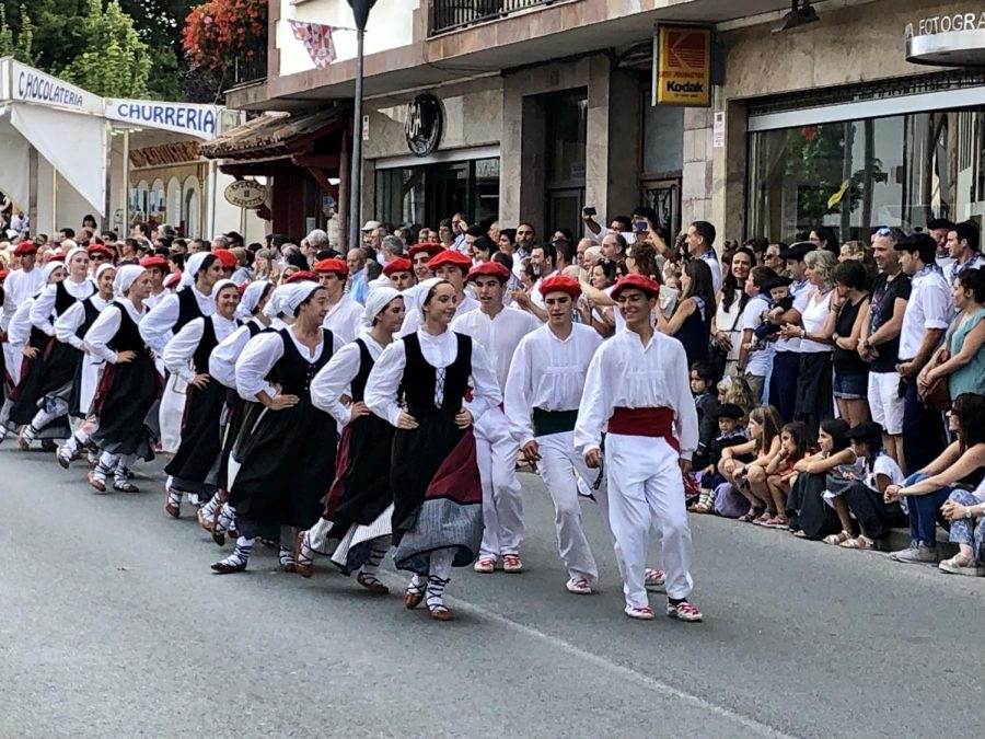 The dancers were part of a traditional annual parade with elaborate floats depicting traditional farm life.