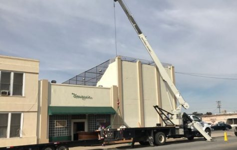 A crane was used to move the historic bar from Noriega's to the Kern County Museum.