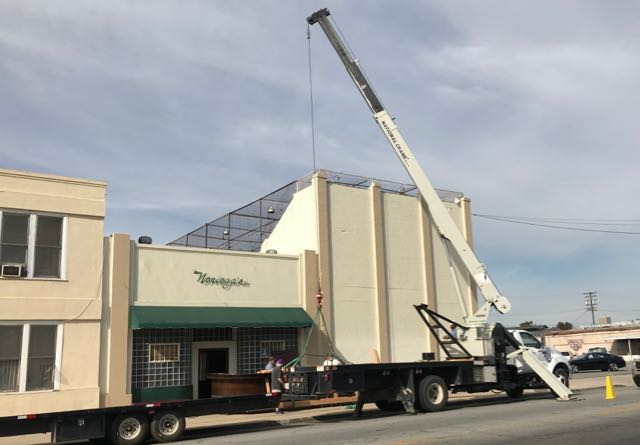 A crane was used to move the historic bar from Noriega's to the Kern County Museum after closing of restaurant.