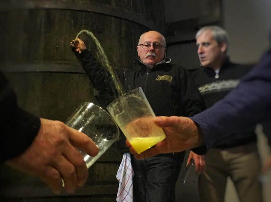 Txotx time, when the cider is released from the barrel. Here by owner Jose Angel Goñi