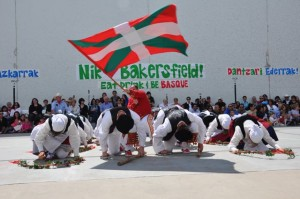 The Basque flag is waved proudly during a special dance.