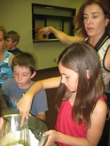 Kids make crepes at Basque camp.