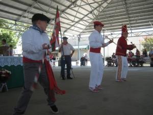 Klika members twirl their batons