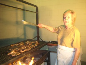 Danielle Arretche Osowiecki tends the lamb chops for the Chalet's monthly barbecue