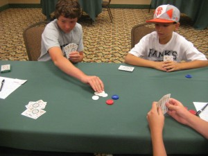 Josh Pese and Alex Goyhenetche play against each other in the junior mus tournament.