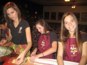 Gauden Bat dance group members prepare appetizers.