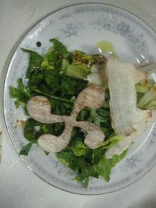 A crunchy lauburu atop the salad