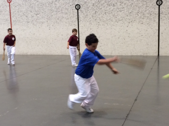 Youngsters learn pala at the Basque Cultural Center fronton.