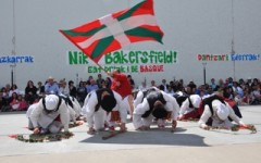 The Basque flag flies during dancing at the Bakersfield fronton.