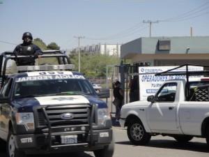 Heavily armed police patrol the streets of Juarez. Photo: Courtesy of Judith Torrea