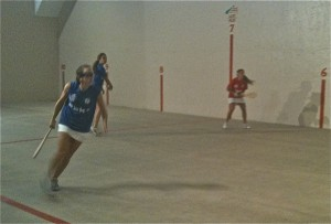 Women play pala at the Boise fronton.