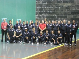 Members of Team USA and other pilotaris on the fronton. Photo: Courtesy of Xabier Berrueta, U.S. Federation of Pelota.